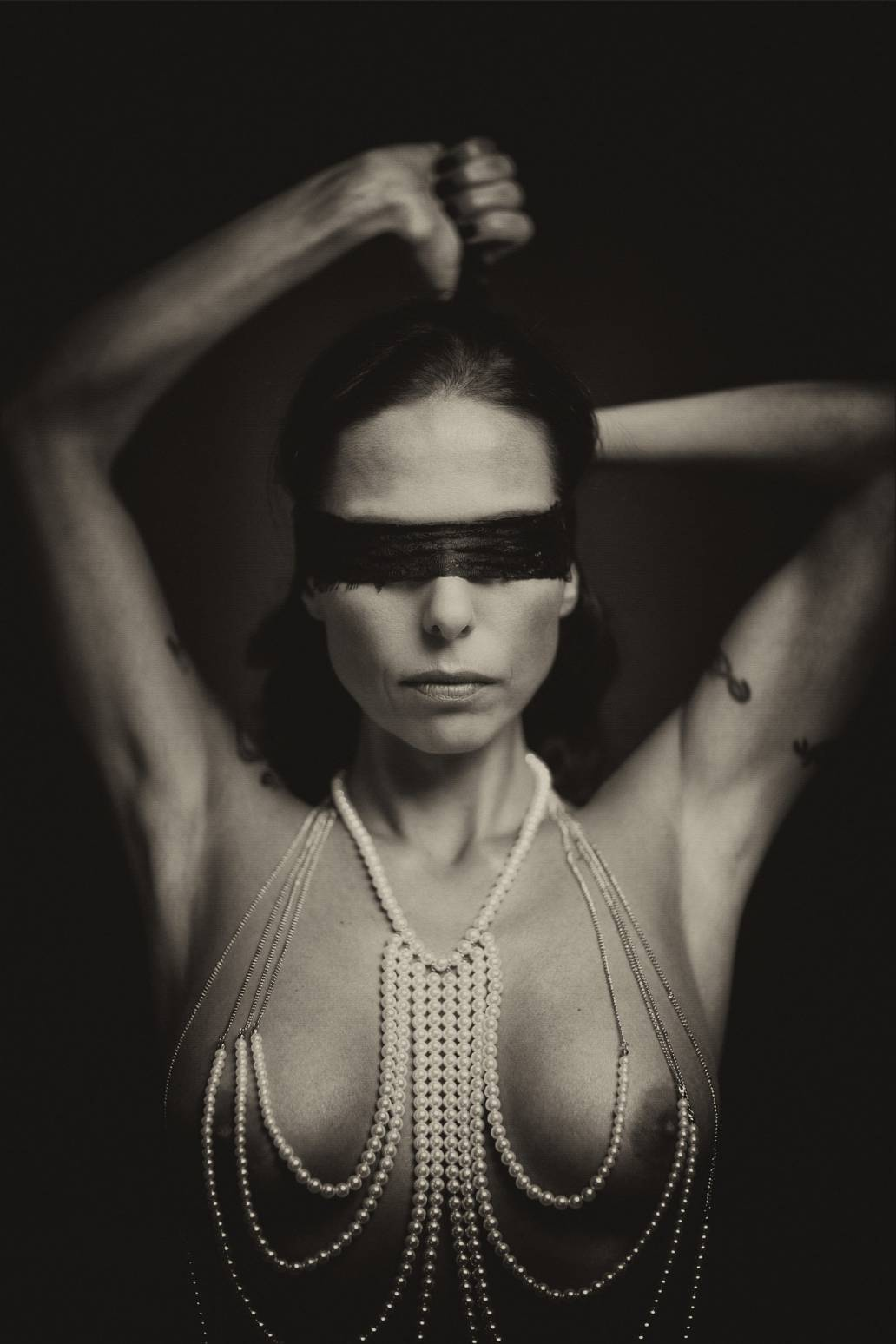 blindfold-and-pearl-necklace